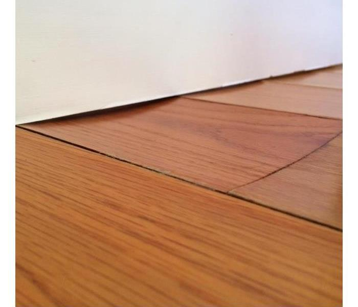 Wooden flooring bubbling up due to neglected water damage